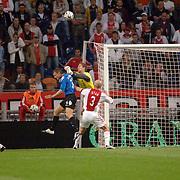 NLD/Amsterdam/20060823 - Ajax - FC Kopenhagen, keeper Maarten Stekelenburg en verdediger Jaap Stam stoppen kopbal van Michael Gravgaard