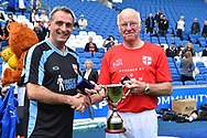 England over 60's manager Stuart Langworthy with Tommy Charlton of England and the Just International Cup  at full time during the world's first Walking Football International match between England and Italy at the American Express Community Stadium, Brighton and Hove, England on 13 May 2018. Picture by Graham Hunt.