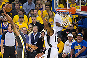 Golden State Warriors forward Andre Iguodala (9) attempts to dunk the ball over San Antonio Spurs forward LaMarcus Aldridge (12) during Game 2 of the Western Conference Quarterfinals at Oracle Arena in Oakland, Calif., on April 16, 2018. (Stan Olszewski/Special to S.F. Examiner)