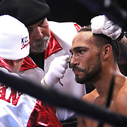 Keith Thurman is seen in his corner between rounds during the Premier Boxing Champions boxing match for the WBA Welterweight title on ESPN at the USF Sun Dome, on Saturday, July 11, 2015 in Tampa, Florida.  Thurman won the bout when the corner of Collazo stopped the fight at the beginning of the eighth round. (AP Photo/Alex Menendez)
