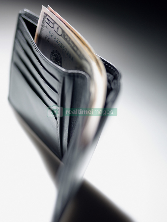 Dec. 14, 2012 - Fifty dollar notes in a wallet (Credit Image: © Image Source/ZUMAPRESS.com)
