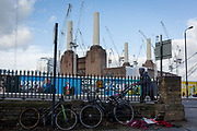 A local man pushes a childs buggy past on-going construction work in Battersea, surrounding Battersea Power Station, on 22 January 2018, in south London, England.