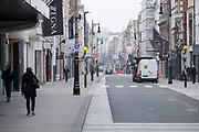 Very few people out along Bond Street as the national coronavirus lockdown three continues and all non-essential shops have to remain closed on 3rd March 2021 in London, United Kingdom. With the roadmap for coming out of the lockdown has been laid out, this nationwide lockdown continues to advise all citizens to follow the message to stay at home, protect the NHS and save lives, and the streets of the capital are quiet and empty of normal numbers of people.