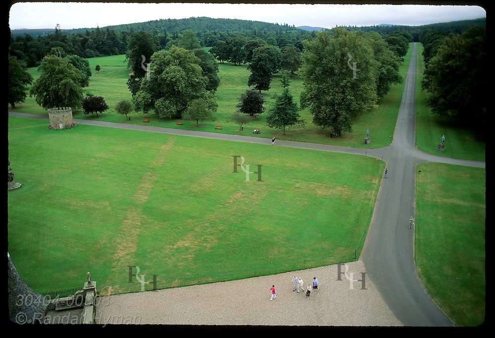 View of tree-lned avenue and castle forecourt from roof of Glamis Castle, childhood home of Queen Mother; Glamis, Scotland.