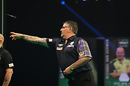 Gary Anderson throws during the Premier League Darts at Marshall Arena, Milton Keynes, United Kingdom on 5 April 2021.