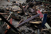 A landslide victim lies under debris in Teresopolis, Rio de Janeiro state, Brazil, Thursday Jan. 13, 2011.  At least 350 people have died after landslides hit early Wednesday, and 50 or more were still missing, according to officials.  <br /> <br /> A series of flash floods and mudslides struck several cities in Rio de Janeiro State, destroying houses, roads and more. More than 900 people are reported to have been killed and over 300 remain missing in this, Brazil's worst-ever natural disaster.