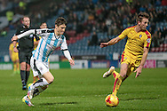 Joe Lolley (Huddersfield Town) takes a shot during the Sky Bet Championship match between Huddersfield Town and Rotherham United at the John Smiths Stadium, Huddersfield, England on 15 December 2015. Photo by Mark P Doherty.