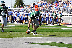 17 September 2011: Bret Swango downs a Titans punt giving the Spartans 1st and ten on the 2 yard line during an NCAA Division 3 football game between the Aurora Spartans and the Illinois Wesleyan Titans on Wilder Field inside Tucci Stadium in.Bloomington Illinois.