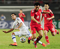 Zheng Zhi of China, front, challenge Derlis Gonzalez of Paraguay, left, during a friendly football match in Changsha city, central China's Hunan province, 14 October 2014.<br /> <br /> Paraguay's dismal run of form continued as they suffered a 2-1 friendly defeat to China on Tuesday (14 October 2014). The South American nation, who came into the game having won two of their previous 13 fixtures, fell short in their bid to pull off a late comeback at Changsha's Helong Stadium. In contrast to their opponents, China have now lost just two of their last 16 matches as they continue to build towards next year's AFC Asian Cup in Australia.
