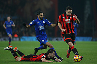 Football - 2016 / 2017 Premier League - AFC Bournemouth vs. Leicester City<br /> <br /> Riyad Mahrez of Leicester City pushes Bournemouth's Harry Arter to the floor in an attempt to win the ball from Bournemouth's Marc Pugh at Dean Court (The Vitality Stadium) Bournemouth<br /> <br /> COLORSPORT/SHAUN BOGGUST