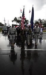 29 August 2007. Lower 9th Ward, New Orleans, Louisiana. <br /> Second anniversary of Hurricane Katrina. The Louisiana National Guard lead residents to the top of the Claiborne Bridge where wreaths and flowers were thrown into the canal in memory of the victims of Hurricane Katrina. Residents had gathered at the hurricane Katrina memorial in the Lower 9th Ward to remember those who perished when the industrial canal levee breached less than a mile from where they stand. Many residents are struggling to return to the still derelict and decimated Lower 9th Ward.<br /> Photo credit©; Charlie Varley/varleypix.com