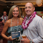 Jennifer Bloech, left, and Chris Bloech pose for a photo Saturday August 2, 2014 during Pipeline to a Cure, a benefit for Cystic Fibrosis at the Country Club of Landfall in Wilmington, N.C. (Jason A. Frizzelle)