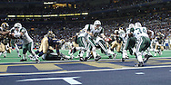 New York Jets quarterback Chad Pennington (10) gets ready to hand the ball off to Jets running back LaMont Jordan (34), during the second quarter against the St. Louis Rams at the Edward Jones Dome in St. Lousi, Missouri, January 2, 2005.  The Jets lost in overtime to the Rams 32-29.