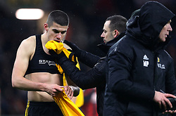 Wolverhampton Wanderers' Conor Coady receives treatment for a facial injury during the Premier League match at Molineux, Wolverhampton.