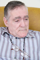 Man with Alzheimer's Disease looking thoughtful,