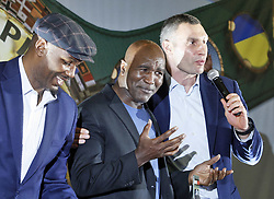 October 2, 2018 - Kiev, Ukraine - Former Boxing Champion LENNOX LEWIS (L), former Boxing Champion EVANDER HOLYFIELD (C) and former heavyweight boxing champion and current Mayor of Kiev VITALI KLITSCHKO (R) attend an authographs session for supporters during the 56th World Boxing Convention in Kiev, Ukraine, on 2 October 2018.The WBC 56th congress in which take part boxing legends Evander Holyfield,Lennox Lewis, Eric Morales and about 700 participants from 160 countries runs in Kiev from from September 30 to October 5. (Credit Image: © Serg Glovny/ZUMA Wire)
