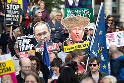 © Licensed to London News Pictures . 03/06/2019. Manchester, UK. Vladimir Putin and Donald Trump I LOVE BREXIT placards . A Manchester Together Against Trump demonstration in Cathedral Gardens , central Manchester , during the first day of US President Donald Trump's visit to the UK . Photo credit: Joel Goodman/LNP