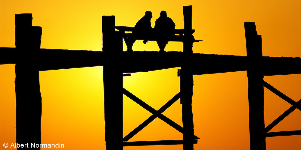 Two Monks in silhouette on U Bein bridge having a conversation
