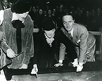 1936 Myrna Loy's hand/footprint ceremony at Grauman's Chinese Theater with William Powell (right)