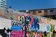 USA, New York city, Queens,  long island city ,  Aerosol art and artists in Five points  , art graffiti on the walls of a commercial building, Phun factory ,  meeting of old graffitis artist. under the subway line number 7