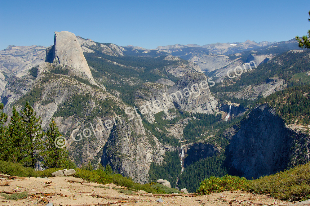 View looking north from Glacier Point. Half Dome upper left Vernal and Nevada Falls middle right.