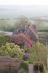 View towards the Priest's House from the Tower at Sissinghurst Castle Garden at dawn