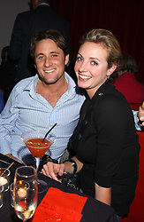 Actor NICK PICKARD and actress ELIZE DU TOIT  at a party for the relaunch of Pizza on The Park, 11 Knightsbridge, London on 20th October 2005.<br /><br />NON EXCLUSIVE - WORLD RIGHTS
