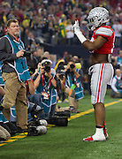 Ezekiel Elliott #15 of the Ohio State Buckeyes celebrates after scoring a 33-yard-touchdown run against the Oregon Ducks in the 1st quarter of the College Football Playoff National Championship Game at AT&T Stadium on January 12, 2015 in Arlington, Texas.  (Cooper Neill for The New York Times)