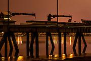 A long exposure at night silhouettes the  the Kenai City Dock and the Kenai River.