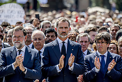 King Felipe VI of Spain and Prime Minister Mariano Rajoy among thousands observe a minute of silence on the Plaza Cataluna to pay tribute to the victims of the attack in Barcelona, Spain, on August 18, 2017. At least 13 people died and some 100 were injured when a van crashed into pedestrian. Photo by Robin Utrecht/ABACAPRESS.COM