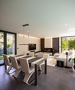 Modern living room overlooking the garden and swimming pool. Nobody inside