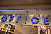 Sign for the clothing brand and shoe shop Office in Birmingham, United Kingdom.
