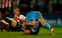 Photo: Richard Lane.<br />Cheltenham Town v Wycombe Wanderers. Coca Cola League 2. Play off Semi Final, 2nd Leg. 18/05/2006. <br />Wycombe's Tommy Mooney goes down injured.