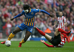 Shrewsbury Town's Aristote Nsiala and Lincoln City's Daniel M Rowe in action during the Checkatrade Trophy final at Wembley Stadium, London.