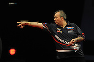 Phil Taylor of Eng in action during his victory over Wes Newton. McCoy's Premier league darts, week 7 event at the Motorpoint Arena in Cardiff, South Wales on Thursday 21st March 2013. pic by Andrew Orchard, Andrew Orchard sports photography,