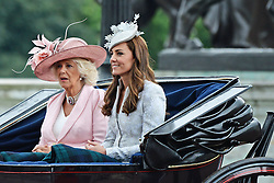 © Licensed to London News Pictures. 14/06/2014. London, UK Camilla Duchess of Cornwall; Catherine Duchess of Cambridge,Trooping the Colour, Buckingham Palace, London UK, 14 June 2014. Photo credit : Mike Webster/PIQ/LNP