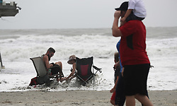 Nick Warner, 31, and Tanna Johnson, 31, get hit by a rogue wave brought by hurricane Dorian at the Cocoa Beach Pier, on Tuesday, September 3, 2019. Photo by Ricardo Ramirez Buxeda/ Orlando Sentinel/TNS/ABACAPRESS.COM