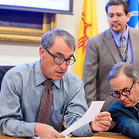 031215       Cable Hoover<br /> <br /> District court judge Louis DePauli, left, Gallup city attorney George Kozeliski and city clerk Alfred Abeita review the voting results during the election certification Thursday at City Hall.