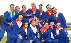 Team Europe's (top row, from the left to right) Henrik Stenson, Alex Noren, Sergio Garcia, captain Thomas Bjorn, Ian Poulter, Jon Rahm, Francesco Molinari (bottom row, from left to right) Justin Rose, Tommy Fleetwood, Tyrrell Hatton, Thorbjorn Olesen, Rory McIlroy and Paul Casey celebrate with the Ryder Cup on day three of the Ryder Cup at Le Golf National, Saint-Quentin-en-Yvelines, Paris.