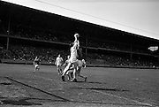 09/06/1963<br /> 06/09/1963<br /> 09 June 1963<br /> Kildare v Louth, Leinster Football quarter final at Croke park, Dublin. Kildare full back (3, name unknown) beats Louth full forward J. Mulroy in this jump for possession in front of the Kildare goalmouth.