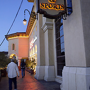 LAS VEGAS, NV - JANUARY 15:  People make their way toward the sports book entrance inside the Green Valley Ranch Resort and Spa in Las Vegas on January 15, 2005 to watch everything from horse races to the NFL playoffs. Sports Illustrated rated the sports book, complete with oversize, leather chairs, as one of the top places in the country to watch sports. (Photo by Todd Bigelow/Aurora)