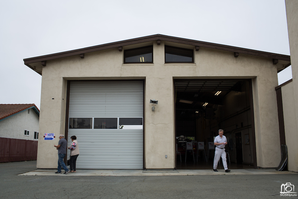Voters exit the Milpitas Fire Station #3 after casting their ballots during the California Presidential Election in Milpitas, California, on June 7, 2016. (Stan Olszewski/SOSKIphoto)