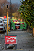 Due to works carried out by contractors on behalf of gas network SGN, plastic barriers block the pavement along Ferndene Road in Herne Hill SE24, on 11th February 2019, in London, England.