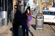 On the last day of the year, people out shopping wearing masks walk along Kings Heath High Street, as many shops remain closed, with shutters down due to Tier Four coronavirus restrictions on 31st December 2020 in Birmingham, United Kingdom. Small businesses have struggled through the Covid-19 pandemic and many have closed down altogether, as the recession in the economy deepens as the crisis continues.