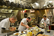 36100 Louisvile, Ky. - Dec. 18, 2014 - Decca Restaurant Sous Chef Cody Stone, (from left) Line Cook Chris Lorio, and Lead Line Cook Noelle Hall prepare meals for the evening's guests.<br /> <br /> William DeShazer for the Wall Street Journal