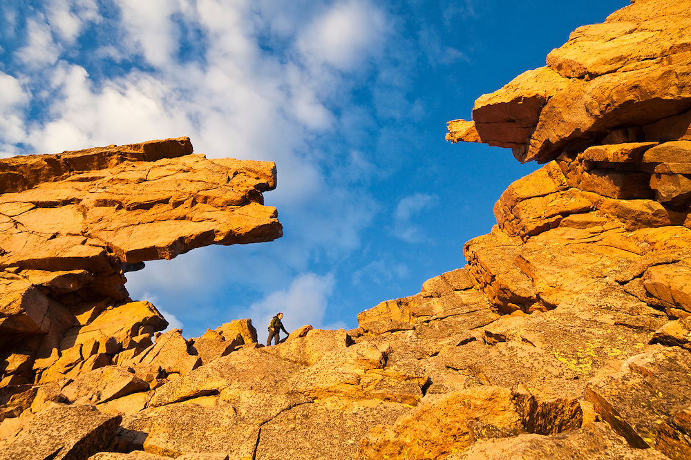 James Meldrum stands in the Keyhole on Longs Peak, Rocky Mountain National Park, Colorado.