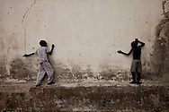Boys play on the pockmarketed wall of a decaying school on May 1, 2010, the day after a mutiny by SPLA general George Athor Deng who was upset with the election results. His mutiny was made possible by guns he had siezed during a governmental disarmnament camapaign earlier this year and he remains at large, one of many variables that could bring South Sudan back to war even if the regions succeds in becoming independent.