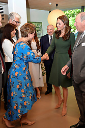 The Duchess of Cambridge shakes hands with journalist Kate Silverton at the Anna Freud Centre in London where she opened their new building, The Kantor Centre of Excellence.