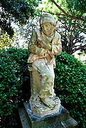 Statue of a sweep boy from the Donizetti opera 'Linda da Chamonix'. Royal Botanic Gardens, Sydney, Australia