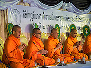 20 JANUARY 2017 - BANGKOK, THAILAND: Buddhist monks lead a merit making ceremony on the plaza in front of Bangkok's City Hall. Hundreds of municipal workers and civil servants made merit by praying and presenting alms to 89 Buddhist monks Friday to mark 100 days of mourning since the death of revered Bhumibol Adulyadej, the Late King of Thailand. The significance of 89 monks is that the King, who died on October 13, 2016, was a few weeks short of his 89th birthday.        PHOTO BY JACK KURTZ
